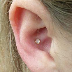 gold heart piercing