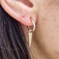 spike gold hoops on 2